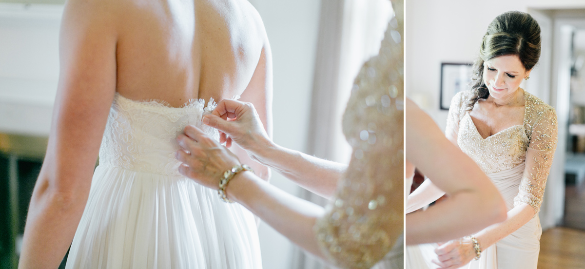 Mother of the Bride helping daughter into wedding dress