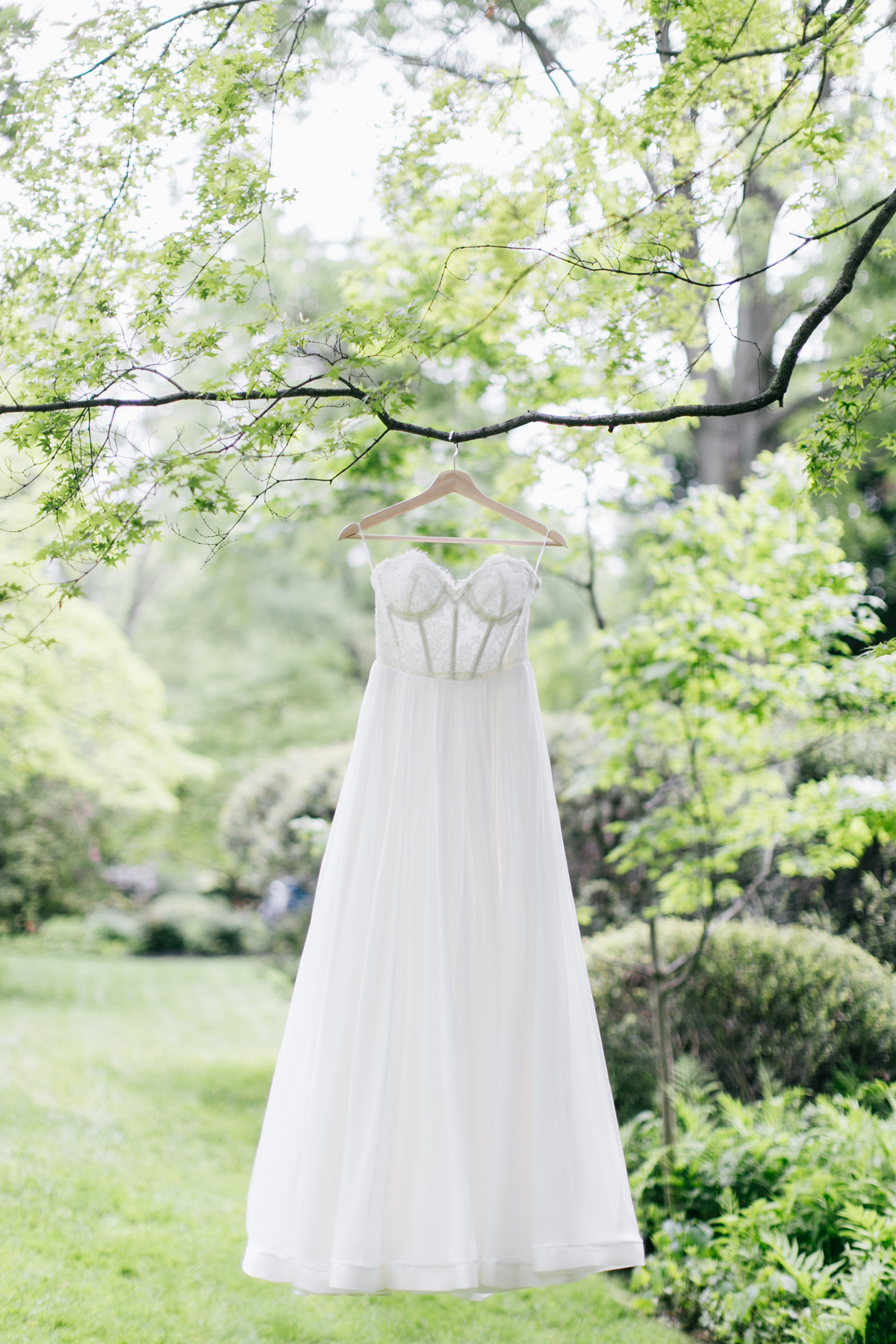 Leanne Marshall wedding gown hanging from a tree